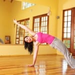 Healthy young woman in gym outfit stretching